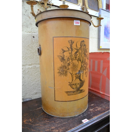 1202 - <strong>An unusual 19th century toleware cylindrical storage bin and cover, </strong>54cm high....