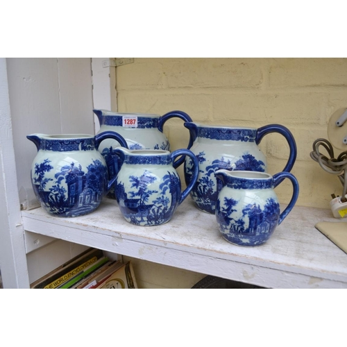 1287 - A graduated set of five reproduction blue and white jugs, 19.5cm high.