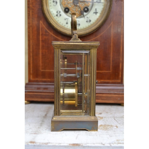 1289 - <strong>An Edwardian mahogany mantle clock,</strong> 30cm high; together with a brass carriage ...