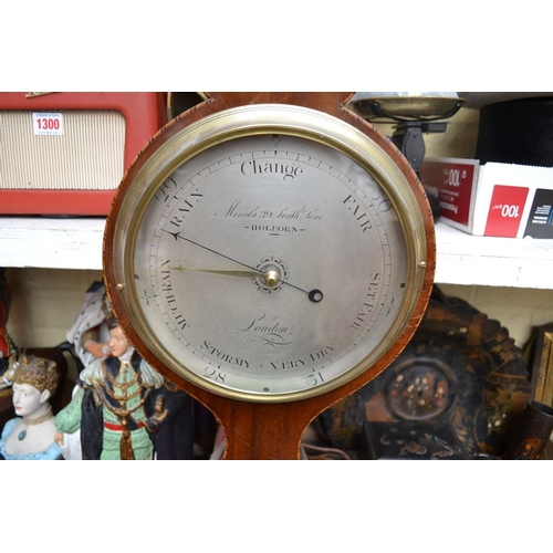 1303 - <strong>A 19th century mahogany and inlaid banjo barometer, </strong>the silvered dial inscribed 'Mi...