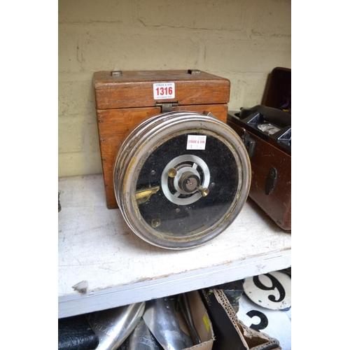 1316 - An oak cased racing pigeon clock.