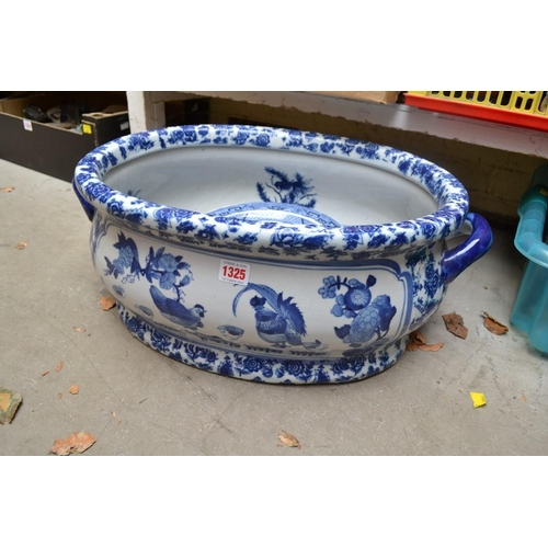 1325 - A reproduction blue and white foot bath, 56cm wide; together with a collection of Wedgwood 'Willow' ...