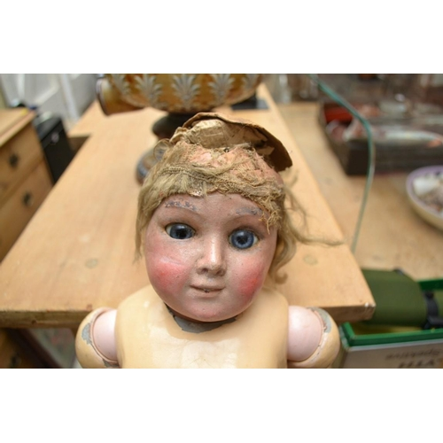 1327 - <strong>A Simon & Halbig bisque head doll;</strong> together with another bisque head doll, (bot...