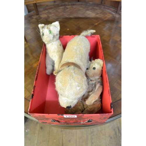 1392 - <strong>Three vintage plush toys,</strong>to include a pull along dog....