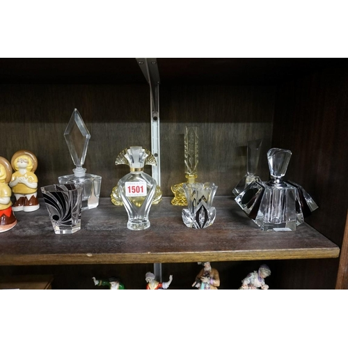 1501 - A small collection of glass scent bottles and similar.