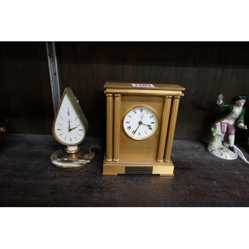 1503 - <strong>A vintage Swiza novelty chamberstick timepiece,</strong>13.5cm high; together with a Loopin...