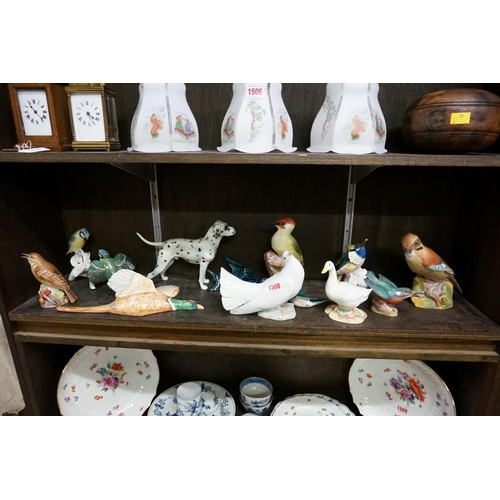 1508 - A collection of pottery and porcelain bird models,to include a Royal Worcester jay; a Royal Worcest...