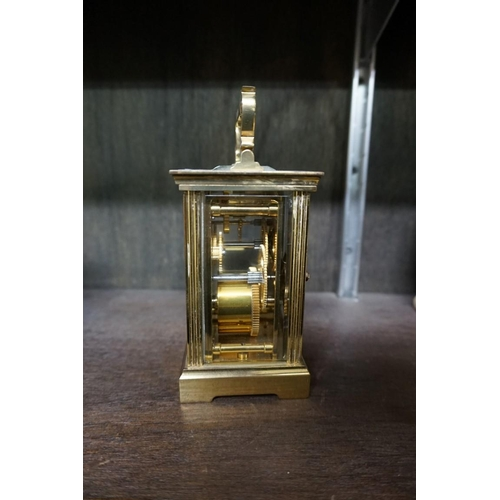 1515 - <strong>A Charles Frodsham brass carriage timepiece, </strong>height including handle 15.5cm, with w...