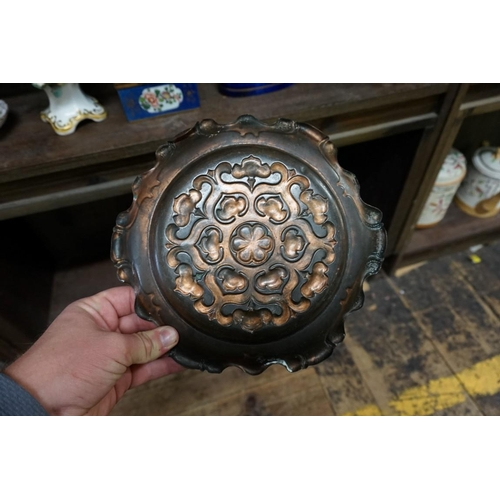 1521 - <strong>A set of three Arts & Crafts embossed copper plates,</strong>23cm diameter....