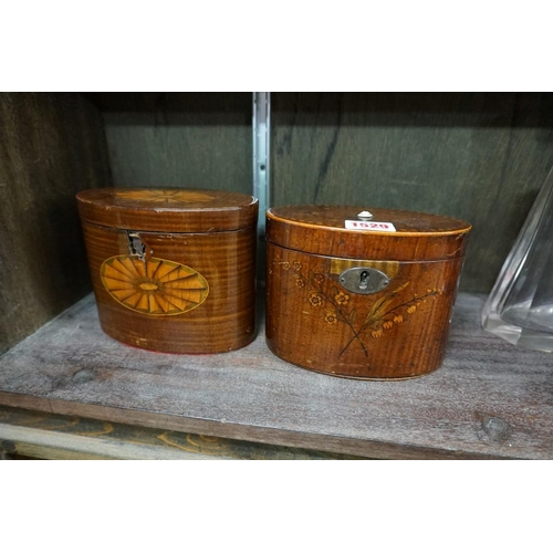 1529 - <strong>Two George III mahogany and inlaid oval tea caddies,</strong>14.5cm wide....