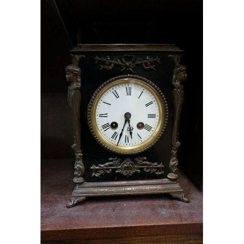 1575 - <strong>An antique ebonized and brass mounted mantel clock,</strong>striking on a bell, 26cm high, ...