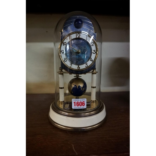 1606 - <strong>A vintage Kaiser 'Universe' 400 day anniversary clock, </strong>with glass dome, 25.5cm high...