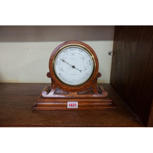 1621 - <strong>An oak cased aneroid barometer,</strong> 20cm high....