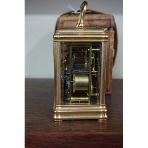 1636 - A good antique gilt brass carriage clock,striking on a gong with alarm and push button repeat, the ...