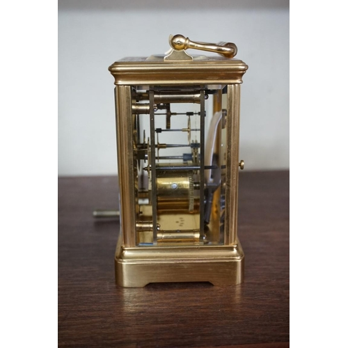 1637 - <strong>A gilt brass carriage timepiece,</strong> height including handle 17cm, with winding key....