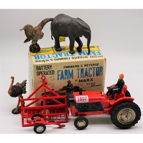 1657 - <strong>A Marx battery operated farm tractor,</strong> boxed; together with three Elastolin animals....