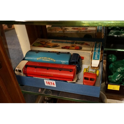 1674 - <strong>Two Dinky 'Foden' trucks;</strong> together with a Crescent Toys 'Scammell Scarab', boxed; a...