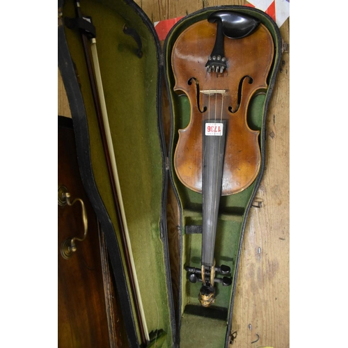 1736 - <strong>An antique Continental violin,</strong>labelled 'Joseph Guarnerius,...1660', with 14in two ...