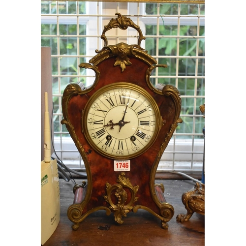 1746 - <strong>A Louis X style tortoiseshell and gilt brass mounted mantel clock,</strong>the gong strikin...