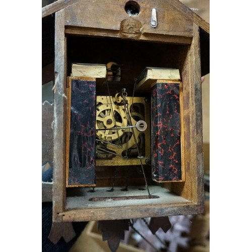 1425 - <strong>Two carved wood cuckoo clocks,</strong> each with weight....