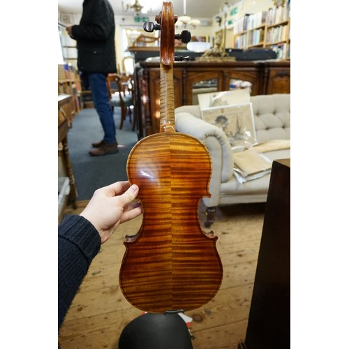 1735 - <strong>An antique Continental violin,</strong>with 14in two piece back, with bow and case....