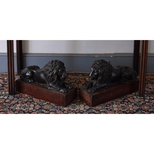 1862 - <strong>(THH) A large and impressive pair of bronze recumbent lions,</strong>each on a Breccia marb...