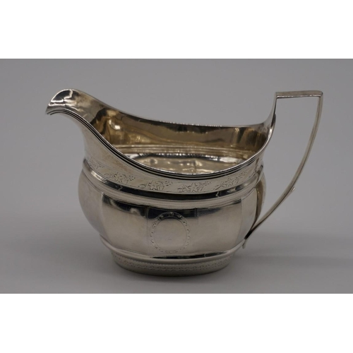 10 - <strong>A George III silver gilt lined milk jug,</strong><em> partial makers mark</em>, London 1802,...