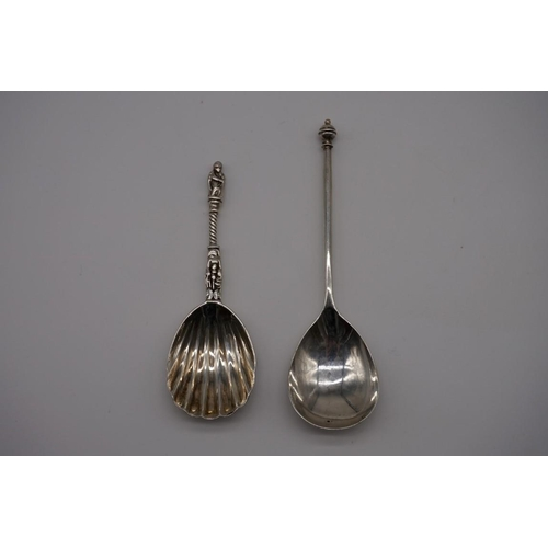 103 - A Victorian silver apostle caddy spoon, makers mark indistinct, London 1874, 10.5cm; together with a...