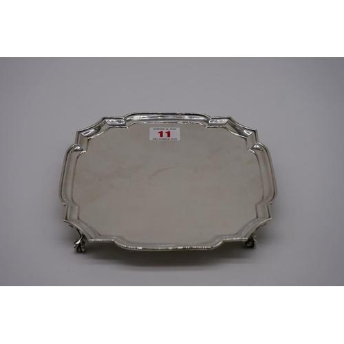 11 - <strong>A silver square salver,</strong> by <em>Harrods Ltd, </em>London 1937, 20cm, 356.5g....