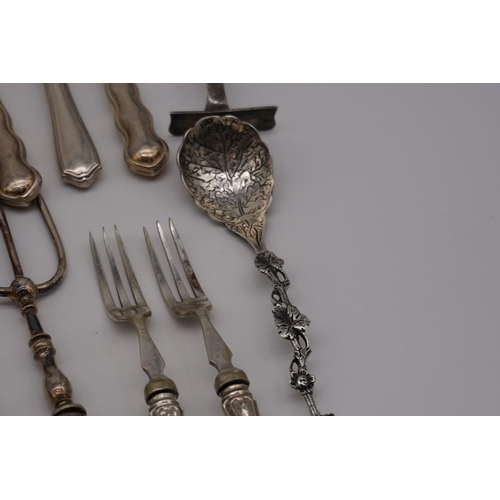 115 - A quantity of silver and silver handled cutlery, to include: a George III tablespoon by Stephen Adam...