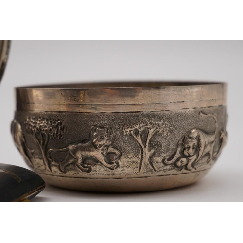 123 - An Asian white metal bowl, decorated wild animals, 9.5cm diameter; together with a circular photogra...