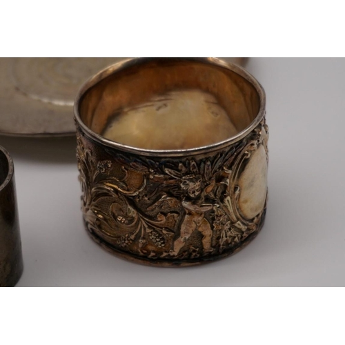 124 - A small quantity of silver, comprising: eight napkin rings and an ashtray; together with two other m...