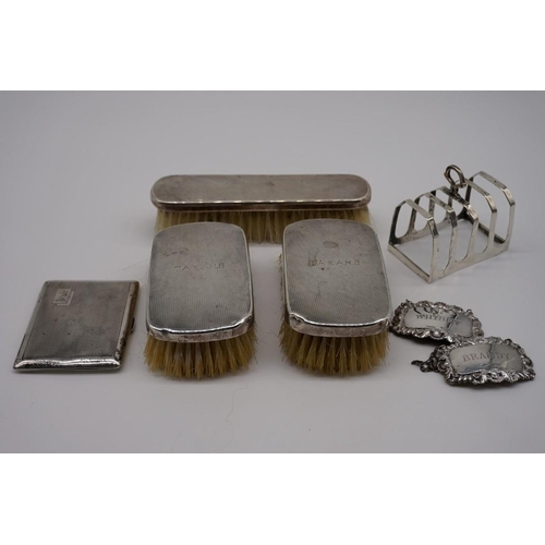 127 - (THH) A small quantity of silver and silver mounted items, to include: a silver four section toast r...