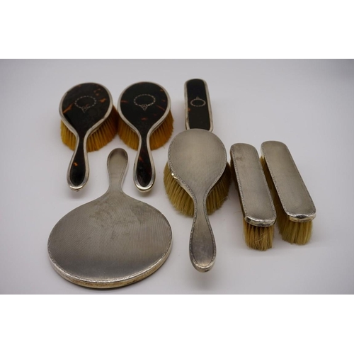 133 - A silver backed four piece dressing set, by Elkington & Co Ltd, Birmingham 1926; together with t...