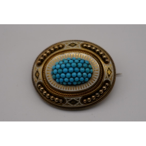 142 - An Etruscan revival oval turquoise and enamel yellow metal mourning brooch, 43 x 33mm....