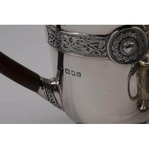 15 - <strong>An Irish silver Celtic Revival three piece tea set,</strong> by <em>Mappin & Webb Ltd, <...