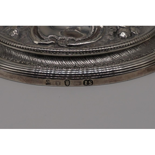 20 - <strong>A George III cast silver candlestick,</strong>by <em>John Schofield,</em>London 1786, havi...