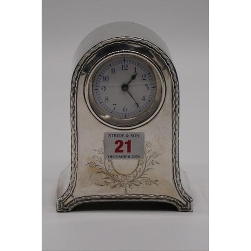 21 - <strong>An Edwardian silver timepiece,</strong>by<em>William Comyns</em><em>, </em>London 1906, 14...