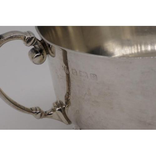 22 - A silver twin handled sugar basin, by Harrods Ltd, Birmingham 1937, 14.5cm diameter, 226g....