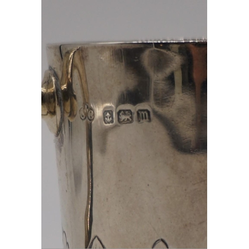 23 - An Edwardian silver Christening mug, by Elkington & Co, Birmingham 1911, 8.5cm high, 137.5g....