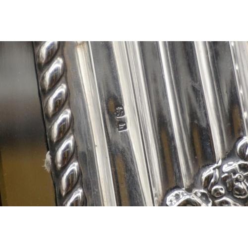 27 - <strong>An impressive Edwardian silver framed easel mirror,</strong> by <em>William Devenport, </em>...