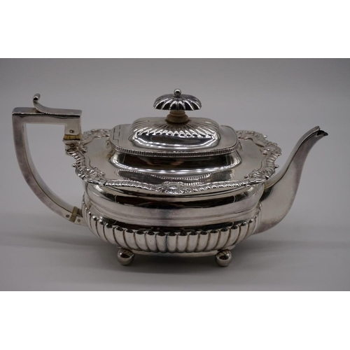 32 - <strong>A George III silver teapot</strong>, by <em>J W Story & W Elliott,</em> London 1810, 13c...