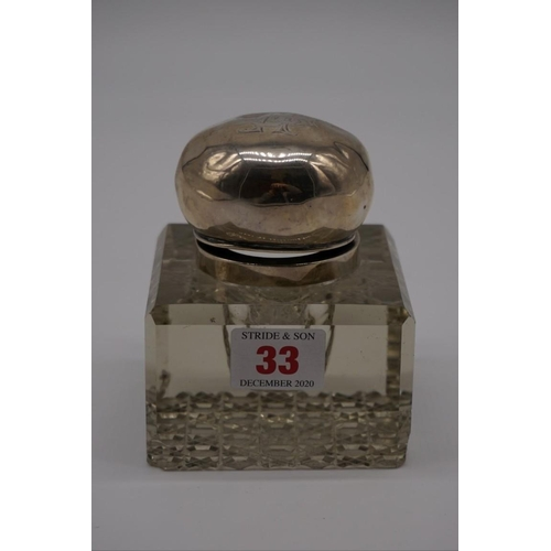 33 - <strong>(THH) An Edwardian silver mounted glass inkwell,</strong>by<em>John Grinsell &am...