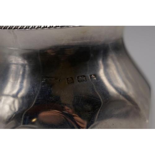 34 - <strong>A silver sugar caster,</strong> by <em>makers mark indistinct,</em> Birmingham 1918, 13cm, 1...