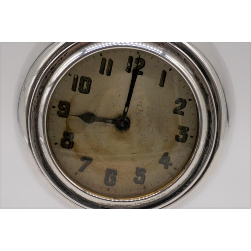 38 - <strong>A silver and turned wood desk clock, </strong>by <em>Charles Perry & Co. </em>Chester 19...