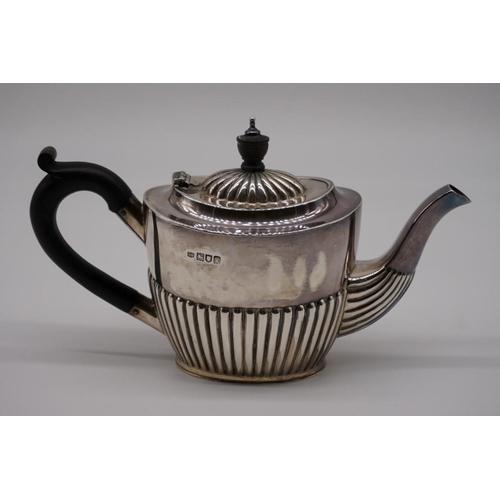 45 - <strong>An Edwardian silver three piece bachelor's tea set, </strong>by <em>Robert Pringle & Son...