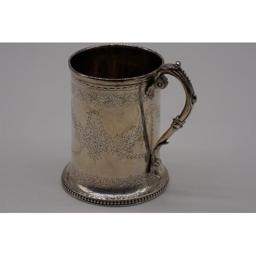 6 - <strong>A Victorian silver Christening mug,</strong> by <em>Alexander Macrae, </em>London 1868, 9cm ...