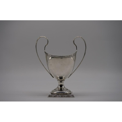 8 - <strong>(THH) An American sterling silver twin handled sugar helmet,</strong> by<em>Howard & Co...