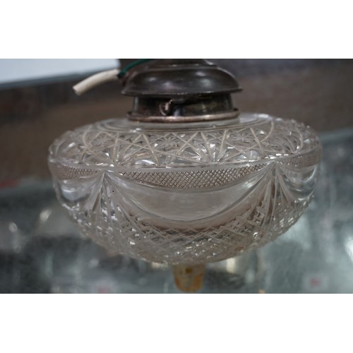 25 - (THH) An Edwardian silver and cut glass Corinthian column oil lamp, byHawksworth, Eyre & Co Ltd...