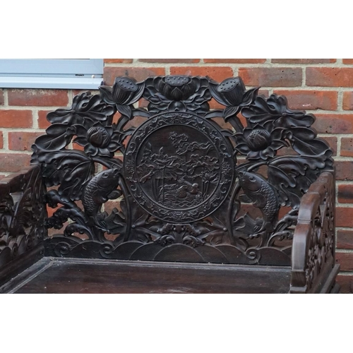 1686 - <strong>A large pair of Chinese carved and pierced hardwood Imperial throne chairs and matching tabl...